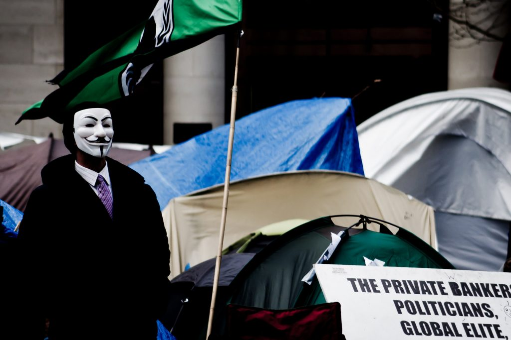 London protester with Guy Fawkes mask