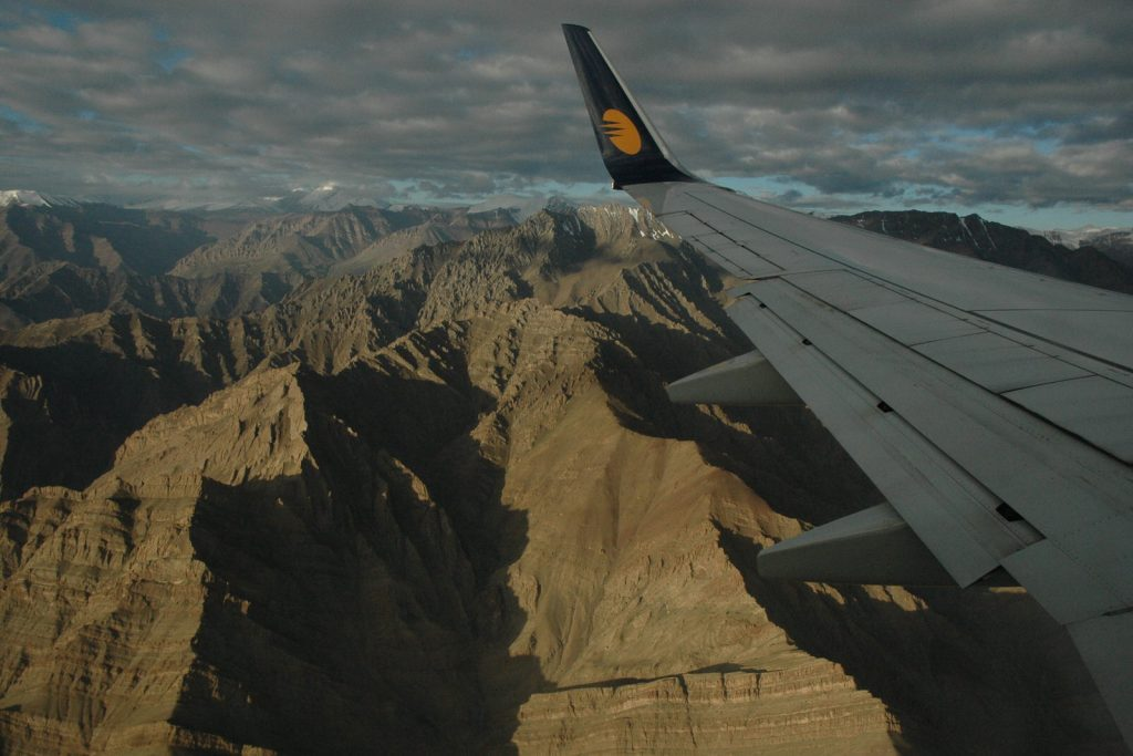Plane wing with mountains on the approach to Leh