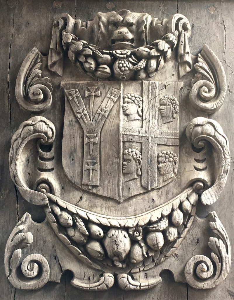 A carved wooden door panel at Canterbury Cathedral